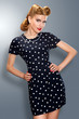 Pin-up girl in retro vintage old-fashioned dress posing