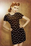 Pin-Up retro girl in classic fashion polka dots dress - grunge