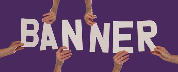 White alphabet lettering spelling BANNER