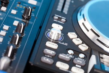 Closeup detail of a DJs deck with turntable