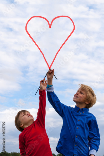 kids painting heart shape in the sky
