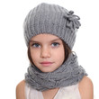 little girl in a knitted hat and gray scarf