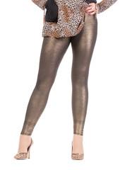 Sexy stylish legs in shimmering golden leggins