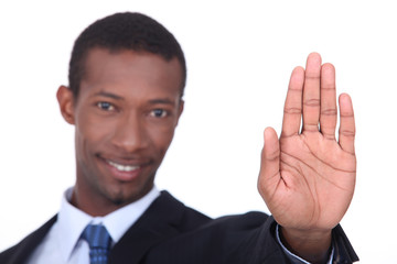 Businessman holding his hand in a stop gesture