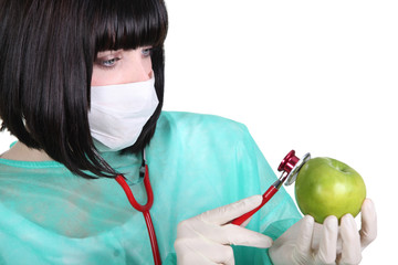 Female medic checking the pulse of an apple