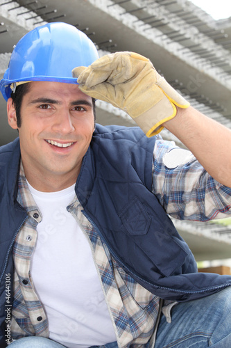 Smiling construction worker wearing a hardhat