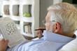 Senior man doing crossword