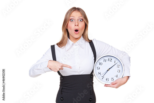 woman pointing at the clock