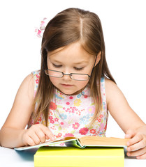 Cute little girl with book