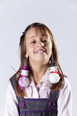 Little girl with snowman decoration earings