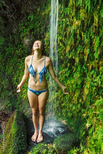 Woman underwaterfall in Hawaii