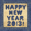 Happy New Year 2013! - made of denim letters on a leather label
