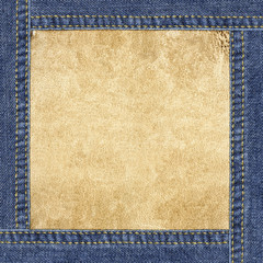 Leather background framed in blue denim