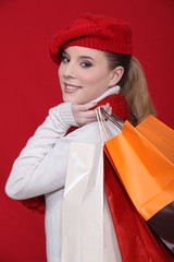 Fashionable woman holding her shopping bags