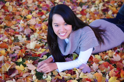 Asian Woman Laying in Leaves