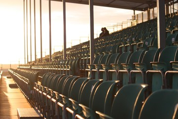 Symmetrical grandstand seating at dusk