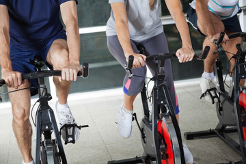Low Section Of People On Exercise Bikes