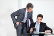 Businessman With Coffee Cup In A Meeting With Colleague