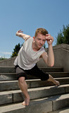 Young Man Practicing Contemporary Dance Exercise on Stairs