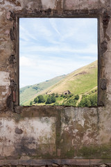 Old room and a lanscape view through the window