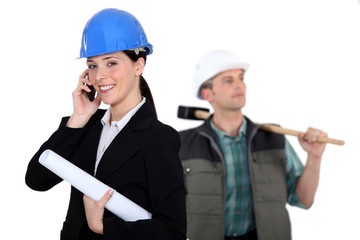 portrait of female architect making a call