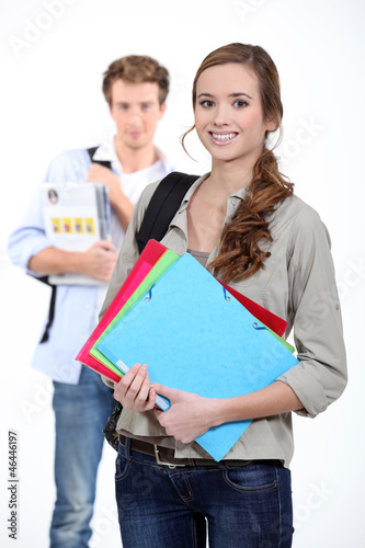 Two students carrying paperwork