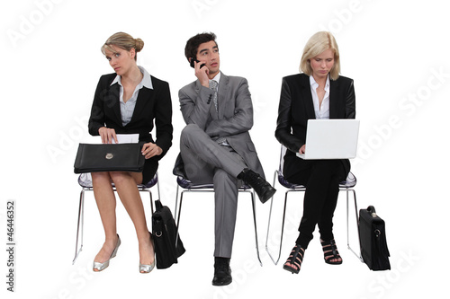 Executives sitting in a row