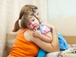woman soothes crying daughter