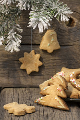 Christmas homemade cookies on wooden boards with fir background