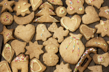 Christmas homemade cookies on wooden boards background