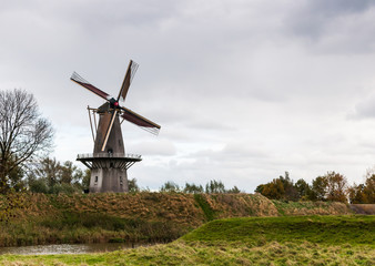 Historic windmill on the wall of an old Dutch fortress