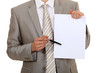 Businessman pointing to a blank sheet of paper