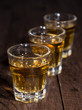 Line of Rum Shots on wooden background