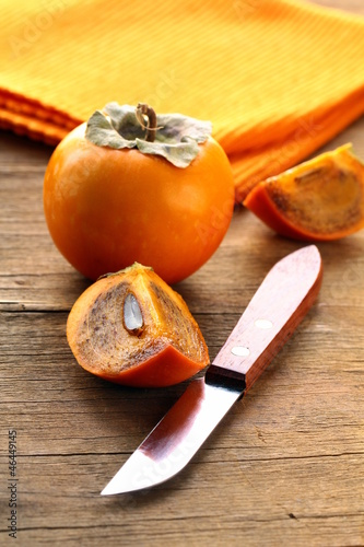 Persimmon fruit on a wooden table