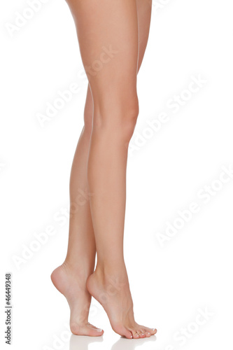 Beautiful woman legs against white background