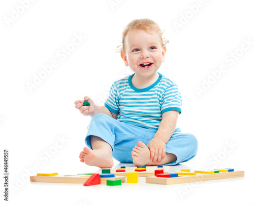 happy kid playing toys