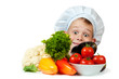 cute chef boy is hiding behind a vegetables. isolated