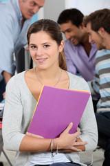 a girl posing in a classroom