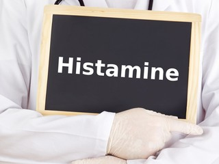 Doctor shows information on blackboard: histamine