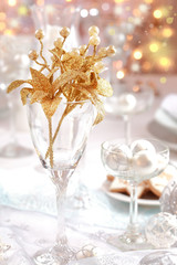 Golden branch on Christmas table
