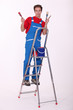 young painter on ladder isolated on white