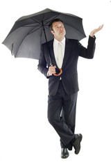 businessman protected by an umbrella