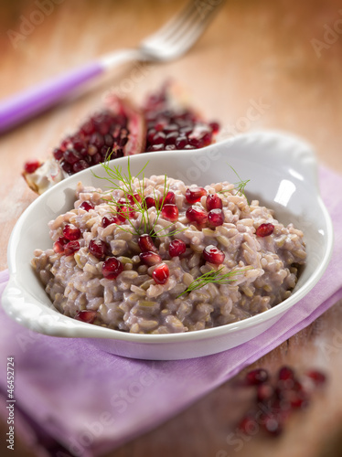 risotto with pomegranate, selective focus