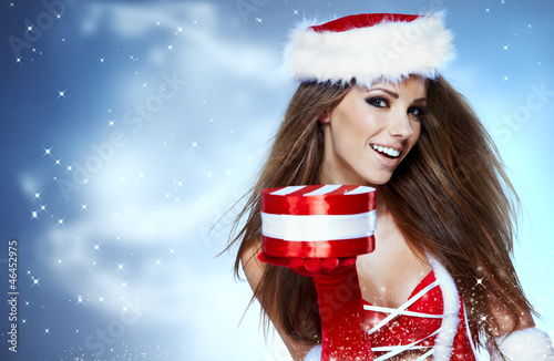 Santa girl on snow blue background