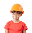 Little girl in a protective helmet winks