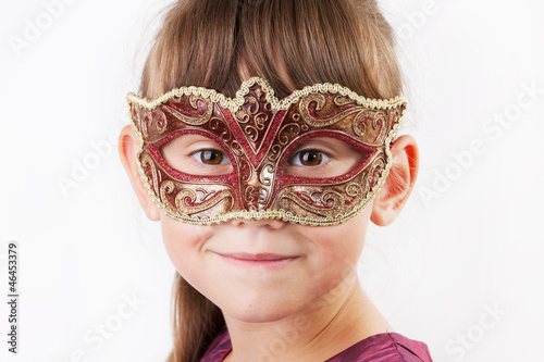 Charming girl in a carnival mask