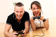Young couple emotionally with passion play video games at home