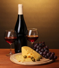 Bottle of great wine with wineglasses and cheese