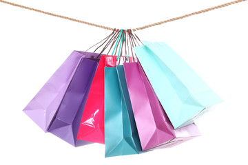 Colored shopping bags on a rope isolated on a white background