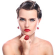 Young and beautiful woman with red jewelry over white background